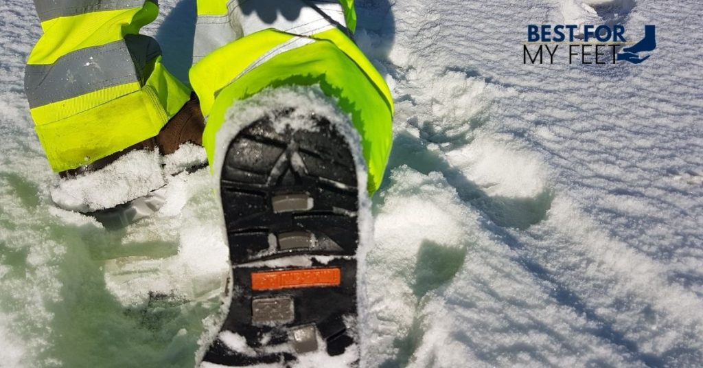 walking in the snow in a pair of insulated work boots that are great for winter