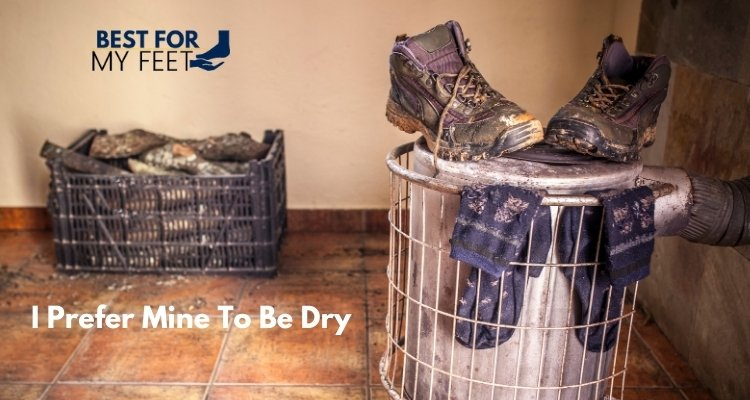 a pair of wet work boots and socks put to dry on the stove