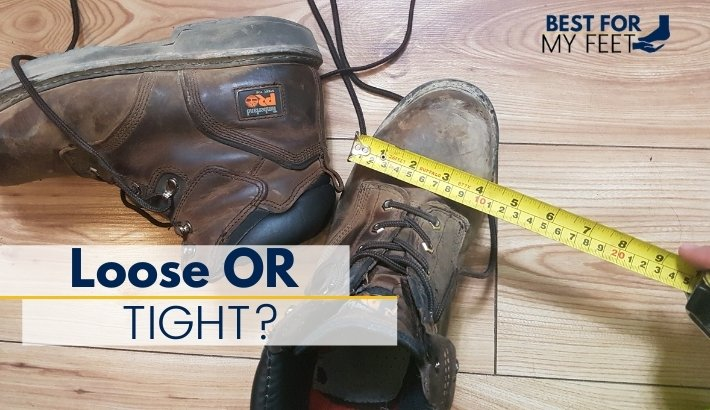 someone is measuring the width of a work boot trying to say how to show if a work boot should fit tight or lose