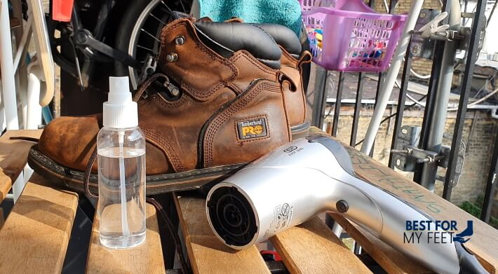 shrinking my work boots using a spray bottle with rubbing alcohol and a hairdryer