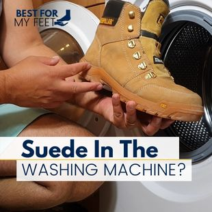 in this image the autor of this article, Adrian is holding his suede leather work boots in front of his washing machine showing that he's about to wash these suede work boots in the washer.